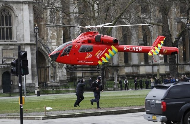 An air ambulance lands in Parliament Square during an incident on Westminster Bridge in London, UK March 22, 2017. Credit: Reuters