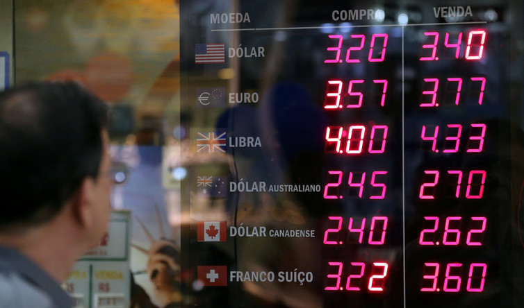 Central banks might launch cryptocurrencies alongside national currencies. Credit: Sergio Moraes/Reuters