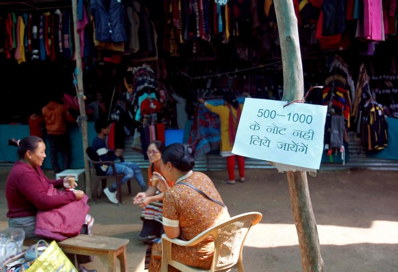 A notice is displayed stating the refusal to accept old Rs 500 and Rs 1000 Indian rupee banknotes at a market in Allahabad, November 24, 2016. Credit: Reuters/Jitendra Prakash/Files
