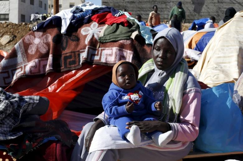 Sudanese refugees from Darfur sit near their tent in an open-ended sit-in in outside the United Nations High Commissioner for Refugees (UNHCR) office, demanding better treatment and acceleration of their relocation, in Amman, Jordan December 11, 2015. Credit: Reuters/Muhammad Hamed/File Photo