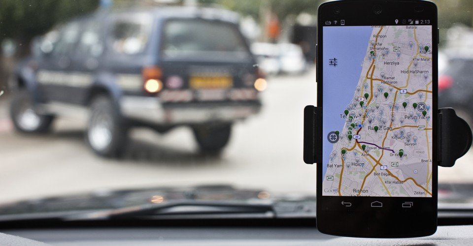 Anagog, an Israeli parking app, is seen on a smartphone in this photo illustration taken in Tel Aviv February 18, 2015. When it comes to helping drivers, there's no shortage of in-car technology from GPS navigation to collision-warning systems. But now start-ups are tackling a perennial source of frustration -- finding a parking space. Picture taken February 18, 2015. To march TECH-ISRAEL/PARKING REUTERS/Nir Elias (ISRAEL - Tags: SCIENCE TECHNOLOGY TRANSPORT BUSINESS) - RTR4QT3N