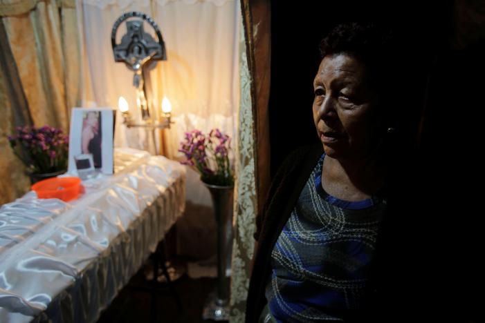The grandmother of Madelin Patricia Hernandez, a victim of a fire at the Virgen de Asuncion children shelter, looks on during her wake in Guatemala City, Guatemala March 9, 2017. Credit: Saul Martinez/Reuters