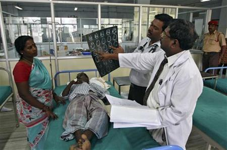 Doctors examine a magnetic resonance imaging (MRI) scan of a patient lying on a bed inside a ward at Rajiv Gandhi Government General Hospital (RGGGH) in Chennai July 12, 2012. Credit: Reuters/BabuDoctors examine a magnetic resonance imaging (MRI) scan of a patient lying on a bed inside a ward at Rajiv Gandhi Government General Hospital (RGGGH) in Chennai July 12, 2012. Credit: Reuters/Babu