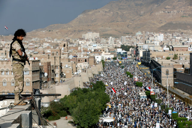 A Houthi militant stands guard on the roof of a building overlooking a rally attended by supporters of the Houthi movement in Sanaa, Yemen March 3, 2017. Credit: Reuters