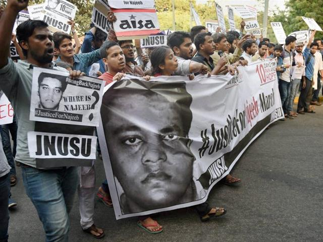 Members of JNUSU and other students' organisations shout slogans during a protest march over missing of student Najeeb Ahmed. Credit: PTI