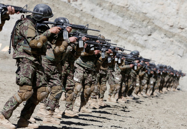 New recruits to the Afghan army Special Forces take part in a military exercise in Rishkhur district outside Kabul, Afghanistan February 25, 2017. Credit: Reuters