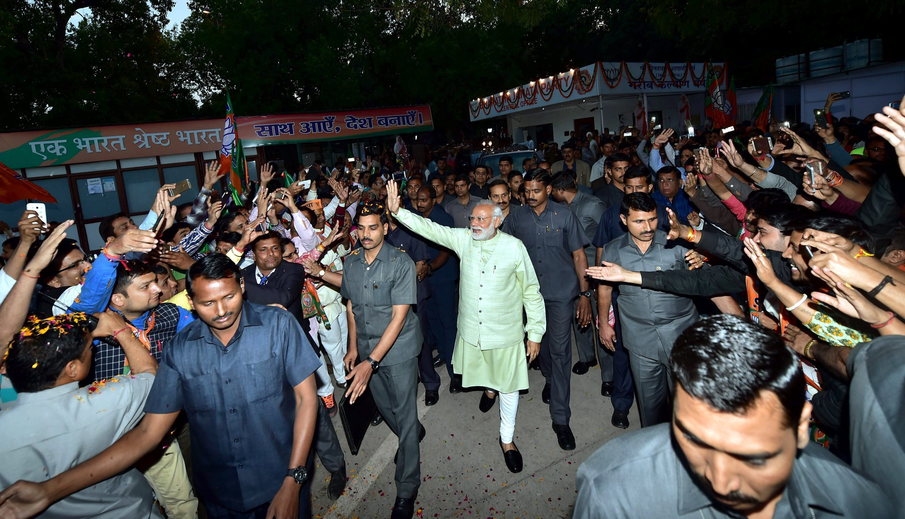 Prime Minister Narendra Modi waves to supporters at the BJP's headquarters as he arrives to its celebrate victory in the UP and other Assembly elections in New Delhi on Sunday. Credit: PTI/ Manvender Vashist