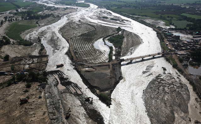 Aerial view of a collapsed road after a massive landslide and flood in Trujillo, northern Peru. Credit: Reuters