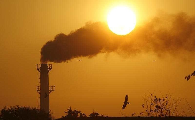 Smoke rises from a chimney of a garbage processing plant on the outskirts of Chandigarh December 3, 2011. Credit: Reuters/Ajay Verma/Files