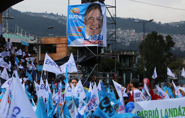 A poster of Guillermo Lasso, presidential candidate from the CREO party, is seen during a campaign rally in Quito, Ecuador, March 29, 2017. Credit: Reuters