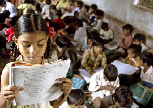 A school girl reads her book inside her class at a government-run school in Madhya Pradesh. Credit: Reuters/Files