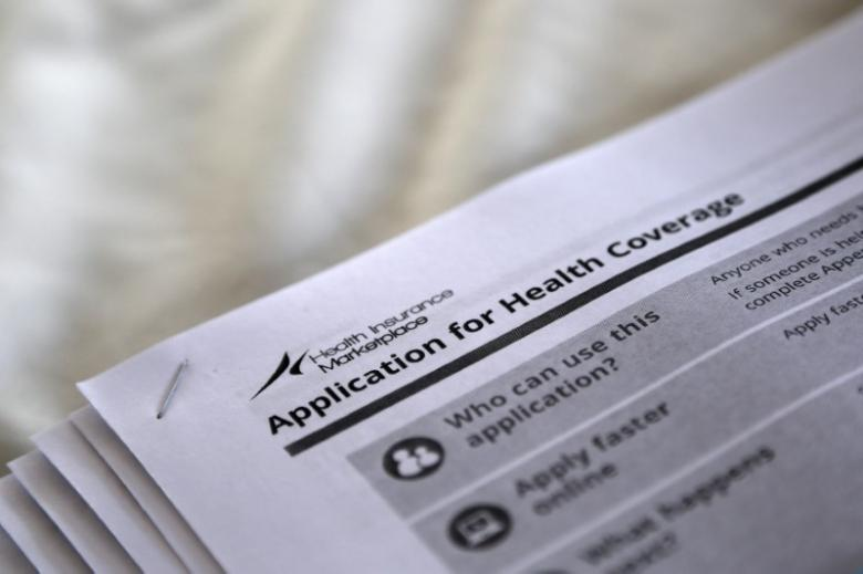 "The federal government forms for applying for health coverage are seen at a rally held by supporters of the Affordable Care Act, widely referred to as ""Obamacare"", outside the Jackson-Hinds Comprehensive Health Center in Jackson, Mississippi, US on October 4, 2013. Credit: Jonathan Bachman/Reuters"