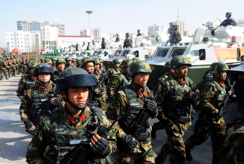 Paramilitary policemen stand in formation as they take part in an anti-terrorism oath-taking rally, in Kashgar, Xinjiang Uighur Autonomous Region, China, February 27, 2017. Credit: Stringer/Reuters