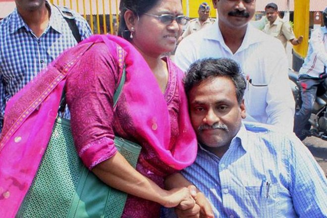 DU Professor G.N. Saibaba, who was arrested for alleged links with Maoists, outside the Nagpur Central Jail with wife Vasanta Kumari in Nagpur. Credit: PTI