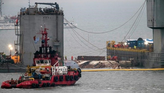 The sunken ferry Sewol is raised during its salvage operations at the sea off Jindo, South Korea, March 23, 2017.  Credit: Reuters