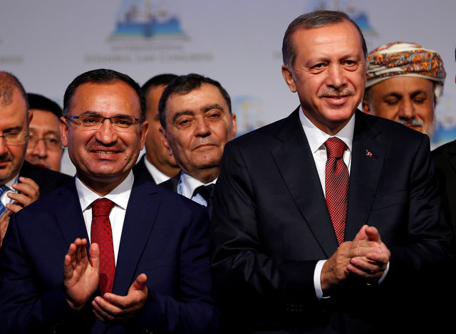 Turkish President Tayyip Erdogan (R) is pictured with justice minister Bekir Bozdag during the International Istanbul Law Congress in Istanbul, October 17, 2016. Credit: Reuters