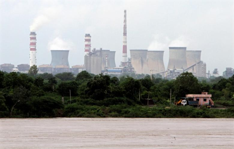 A thermal power station is pictured near the banks of flooded Mahisagar river after heavy rains at Thasra village in Kheda district of Gujarat September 7, 2012. REUTERS/Amit Dave/Files