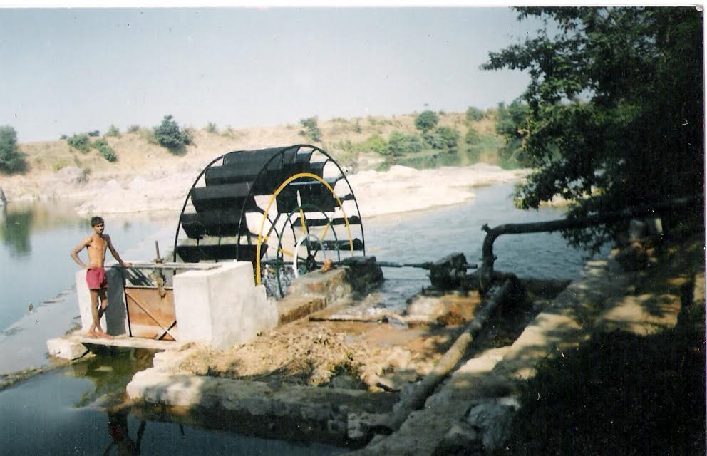 A photograph of Mangal Singh's 'water wheels' turbine in action. Source: Author provided