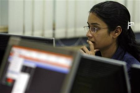 A broker looks at her computer terminal at a stock brokerage firm in Mumbai May 4, 2009. REUTERS/Punit Paranjpe/Files