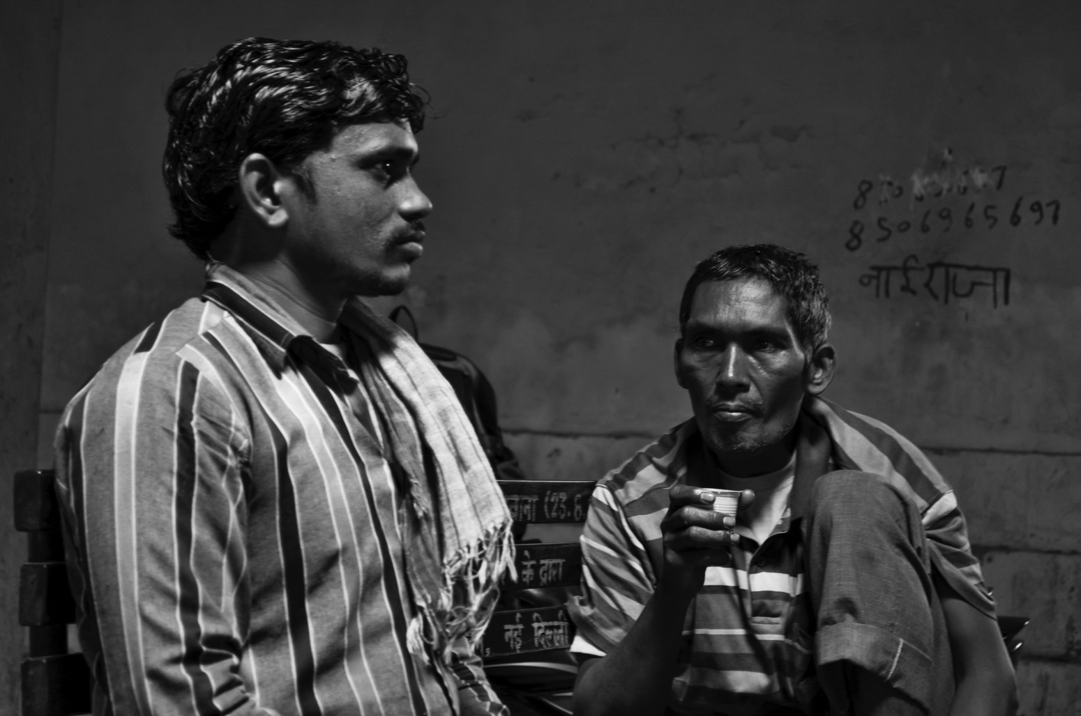 CNG workers in the middle of a conversation. Credit: Wamika Singh