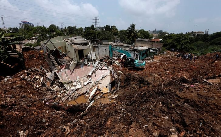 Many Buried, Feared Dead, In Garbage Landslide in Sri Lanka