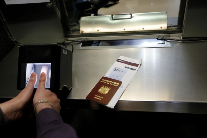A man has his fingerprints electronically taken while taking part in a visa application demonstration during a media tour at the consular section of the Embassy of the United States in Lima October 3, 2014. REUTERS/Mariana Bazo