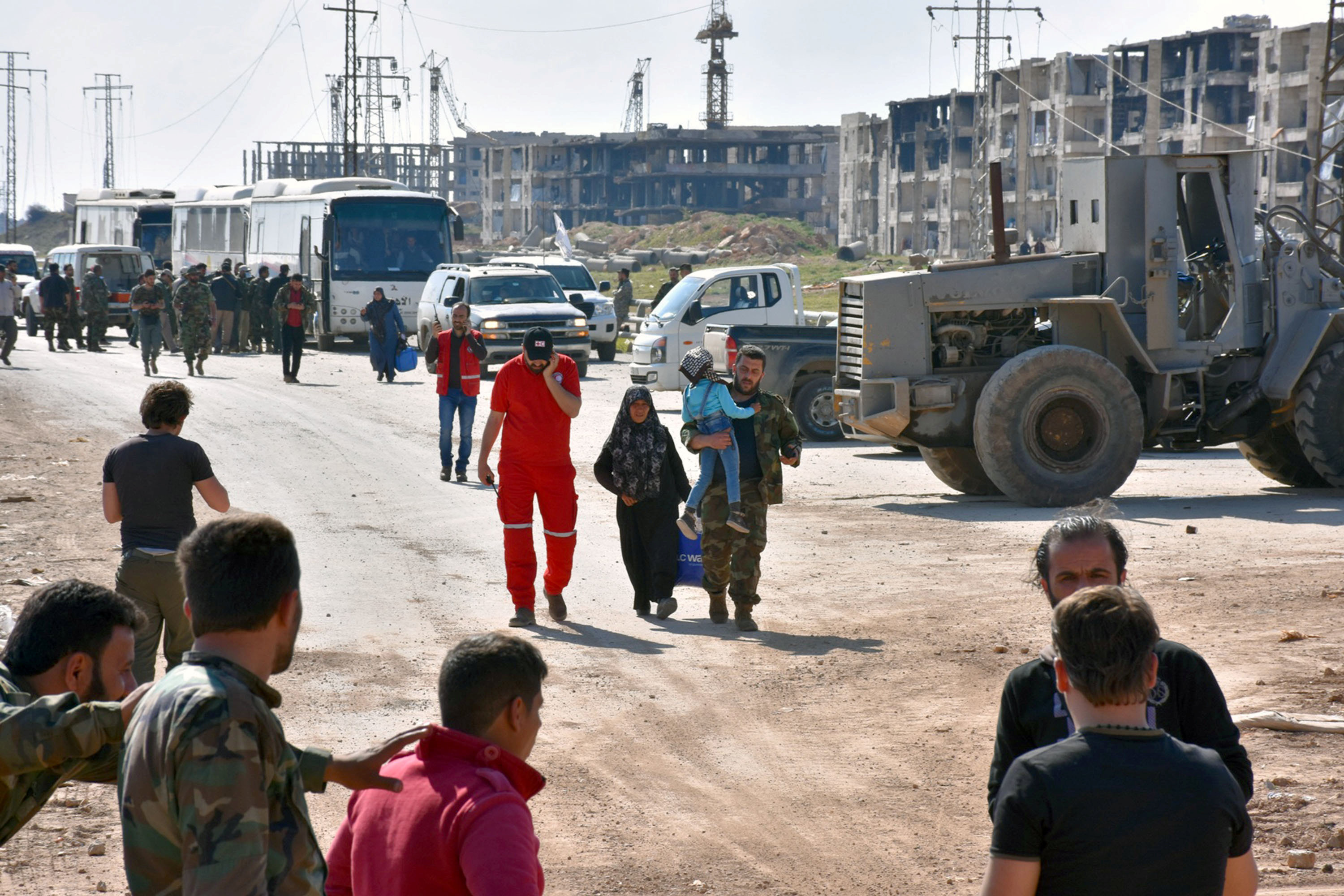 Evacuees from the two rebel-besieged Shi'ite villages of al-Foua and Kefraya, arrive to government-controlled Aleppo, in this handout picture provided by SANA on April 19, 2017, Syria. SANA/Handout via REUTERS