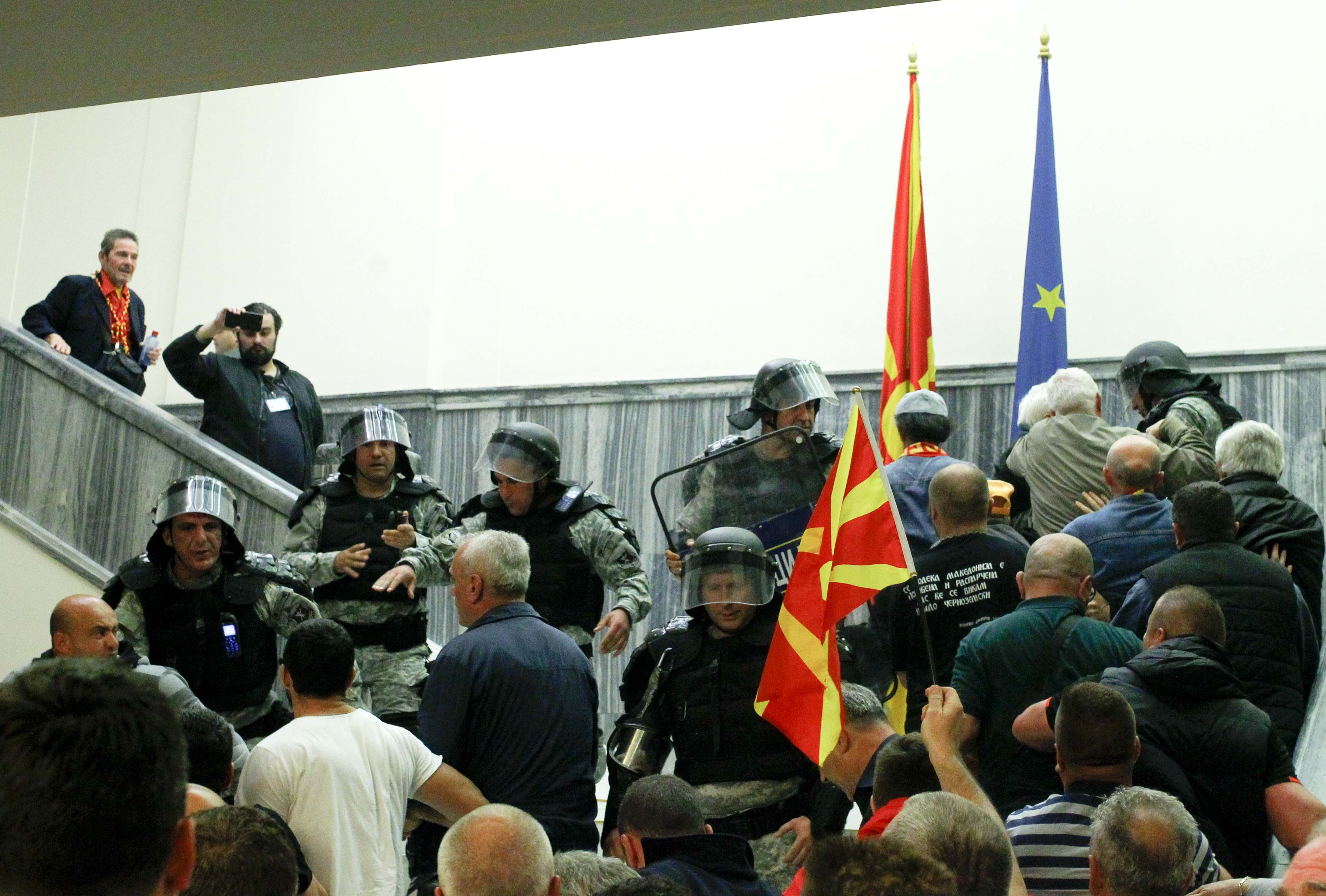 Police try to stop protesters entering Macedonia's parliament after the governing Social Democrats and ethnic Albanian parties voted to elect an Albanian as parliament speaker in Skopje. Macedonia April 27, 2017. Credit: Reuters/Ognen Teofilovski
