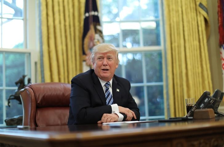 US President Donald Trump speaks during an interview with Reuters in the Oval Office of the White House in Washington, US, April 27, 2017. Credit: Reuters Carlos Barria