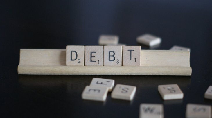 If Money Can Make You Happy, Does Debt Make You Sad?