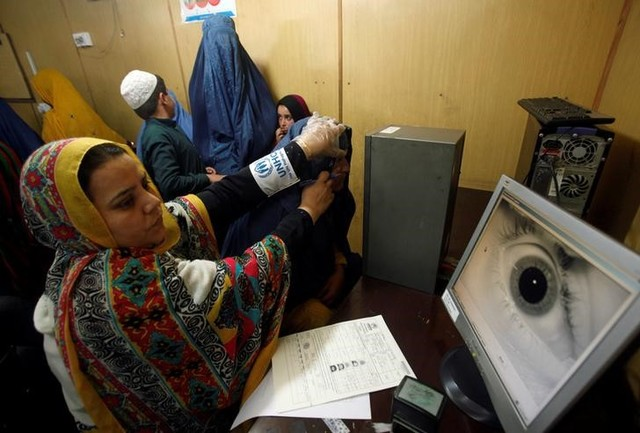 A UN High Commission for Refugees official carries out an IRIS test on an Afghan refugee at the UNHCR office on the outskirts of Peshawar, Pakistan, April 3, 2017. Credit: Reuters
