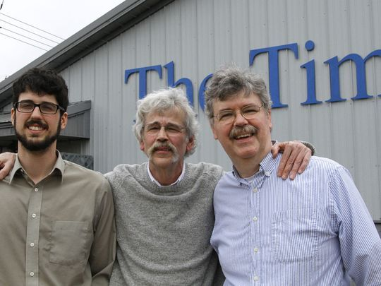 Pulitzer Prize winner Art Cullen (centre) with his brother John (R) and his son Tom (L). Courtesy: The Storm Lake Times