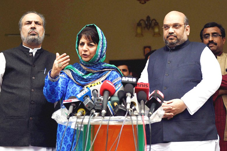 PDP president and Jammu and Kashmir chief minister Mehbooba Mufti with BJP president Amit Shah at a press conference. Credit: PTI/Files
