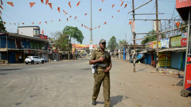A policeman stands guard during curfew at Katchery Bazaar in Bhadrak on Saturday. Credit: PTI