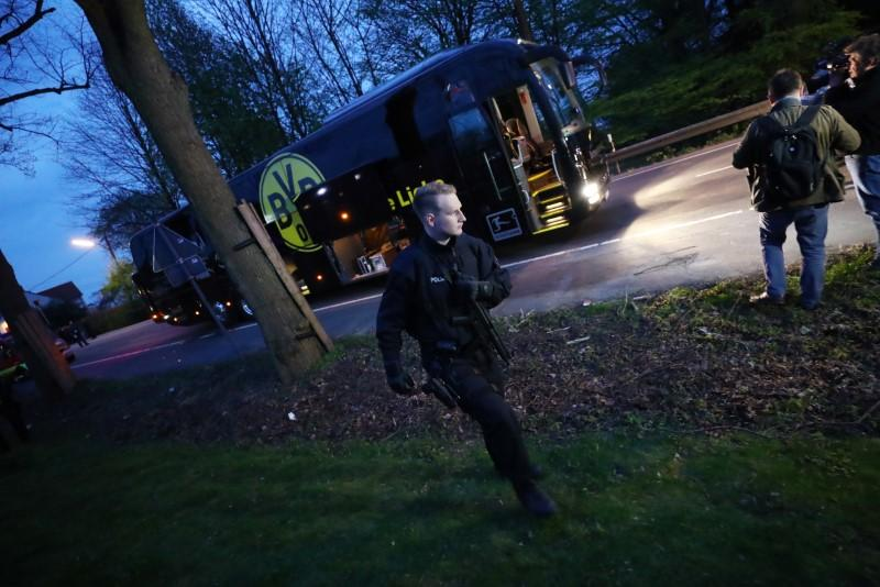 Police with the Borussia Dortmund team bus after an explosion near their hotel before a game. Credit: Reuters/Kai Pfaffenbach Livepic