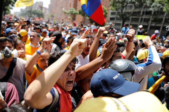 Demonstrators react during an opposition rally in Caracas, Venezuela April 4, 2017. Credit: Reuters