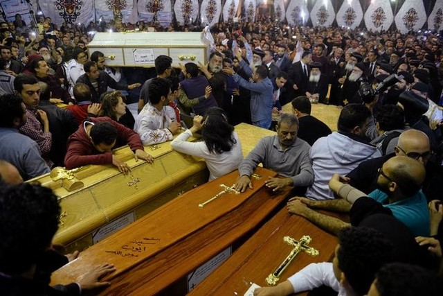 Relatives of victims react to coffins arriving to the Coptic church that was bombed on Sunday in Tanta, Egypt, April 9, 2017. Credit: Reuters
