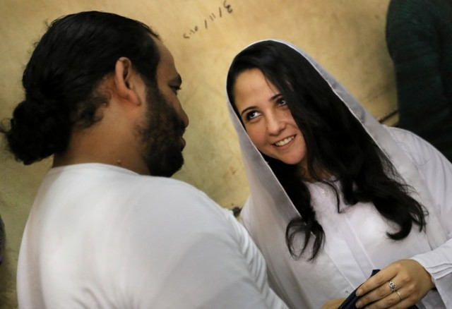 Aya Hijazi and her husband Mohamed Hassanein, founders of Belady, an NGO that promotes a better life for street children, talk inside a holding cell as they face trial on charges of human trafficking at a courthouse in Cairo, Egypt March 23, 2017. Credit: Reuters/Mohamed Abd El Ghany/Files