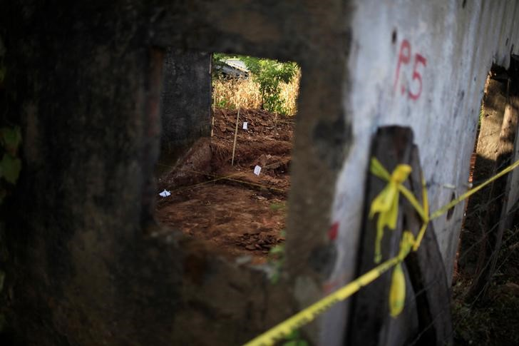 An exhumation site is seen in the village of El Mozote, Meanguera, El Salvador, December 10, 2016. Credit: Reuters/Jose Cabezas