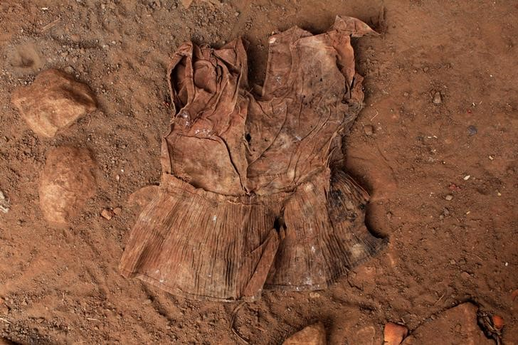 A dress found at an exhumation site is photographed in the village of El Mozote, Meanguera, El Salvador, March 30 , 2017. Credit: REUTERS/Jose Cabezas
