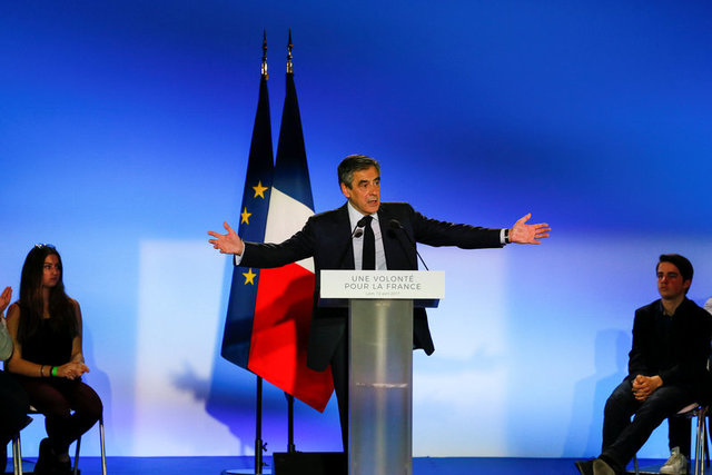 Francois Fillon, former French Prime Minister, member of the Republicans political party and 2017 French presidential election candidate of the French centre-right, attends a political rally in Chassieu, near Lyon, France, April 12, 2017. Credit: Reuters/Robert Pratta