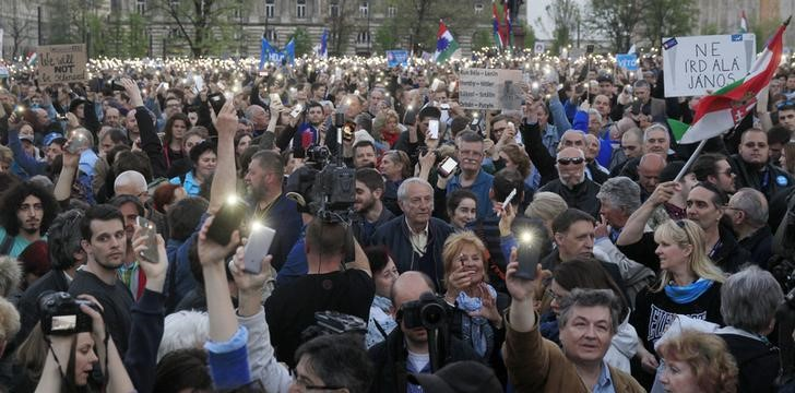 People protest against the bill that would undermine Central European University, a liberal graduate school of social sciences founded by U.S. financier George Soros in Budapest, Hungary, April 9, 2017. Credit: REUTERS/Bernadett Szabo