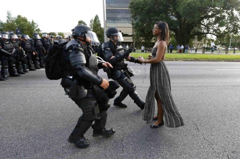 Protestor Ieshia Evans is detained by law enforcement near the headquarters of the Baton Rouge Police Department in Baton Rouge, Louisiana, U.S. July 9, 2016. Credit: Reuters