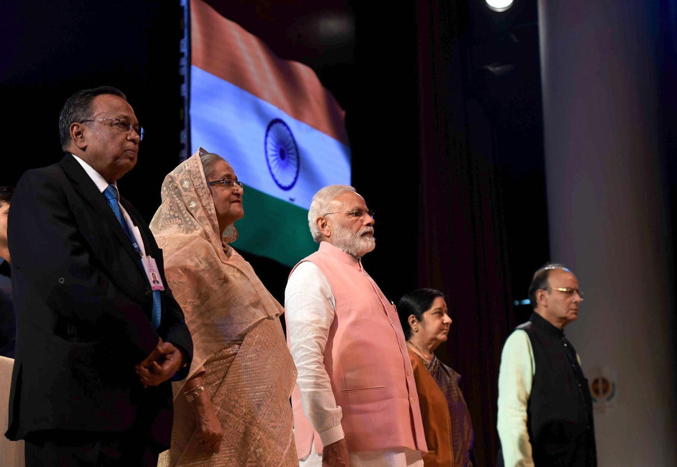 Prime Minister Narendra Modi with his Bangladeshi counterpart Sheikh Hasina at Sommanona Ceremony to salute Indian Soldiers who fought in 1971 war, in New Delhi on Saturday. Also seen are Union ministers Arun Jaitley and Sushma Swaraj. Credit: PTI