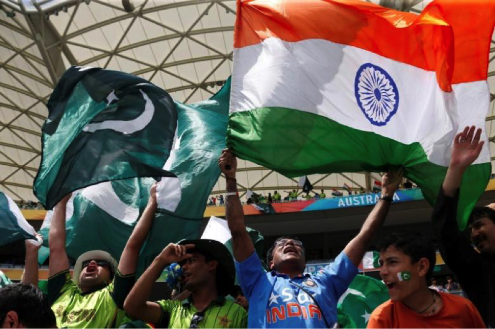Fans of Pakistan's cricket team (L) and India's (R) cheer in the stands before Pakistan's Cricket World Cup match against India in Adelaide, February 15, 2015. Credit: Reuters