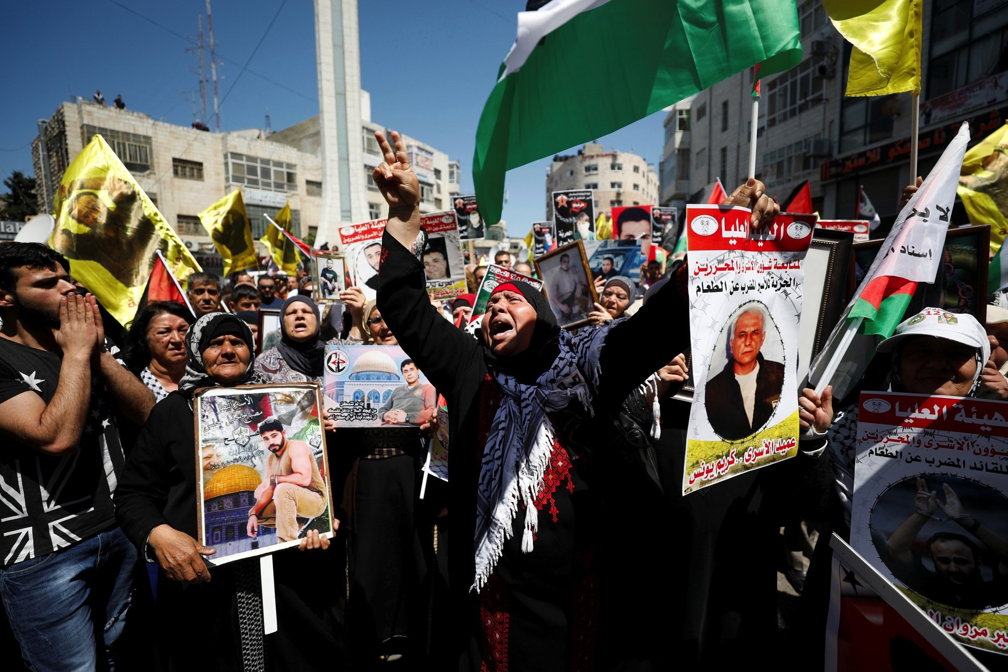 Demonstrators take part in a rally in support of Palestinian prisoners on hunger strike in Israeli jails, in the West Bank city of Ramallah April 17, 2017. Credit: Reuters/Mohamad Torokman