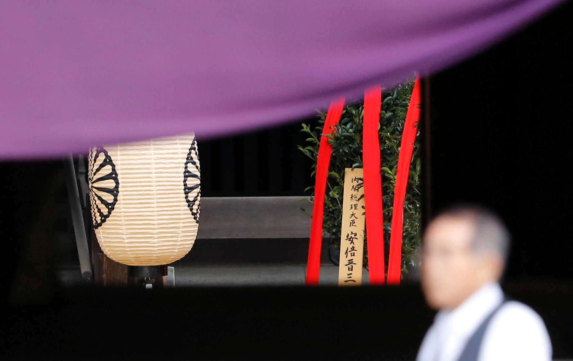 "A wooden sign which reads ""Prime Minister Shinzo Abe"" is seen on a ritual offering, a ""masakaki"" tree, from Abe to the Yasukuni Shrine, inside the main shrine at the controversial shrine for war dead, in Tokyo, Japan April 21, 2017. Credit: Reuters/Toru Hanai"