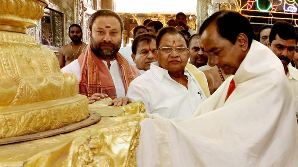 Telangana CM K. Chandrasekhar Rao with TTD officials after donating ornaments worth Rs 5 crore at the golden holy flag mast of the temple of Lord Venkateswara at Tirumala in Tirupati. Credit: PTI/Files