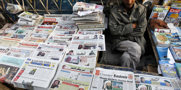 A newspaper vendor in Srinagar, Kashmir. Credit: Reuters/Danish Ismail