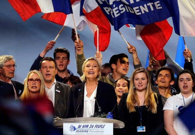 Marine Le Pen, French National Front (FN) political party leader and candidate for French 2017 presidential election, smiles to supporters at the end of a political rally in Bordeaux, France, April 2, 2017. Credit: Reuters